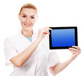 Doctor holding ipad and smiling or digital tablet Stock Photography