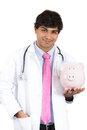 Doctor holding piggy bank medical insurance medicare reimbursement healthcare reform concept confident serious male nurse Royalty Free Stock Image