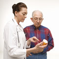 Doctor holding prescription Stock Photo