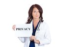 Doctor holding privacy sign portrait female healthcare professional scientist researcher pharmacist isolated white background Stock Photo
