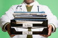 Doctor holding a stack of paperwork Royalty Free Stock Photo