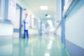 Doctor in hospital corridor, unfocused background