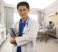 Doctor in hospital room with patient Royalty Free Stock Photo