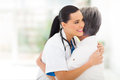 Doctor hugging patient caring young medical senior Stock Photo