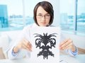 Doctor with inkblot serious psychologist showing paper rorschach Stock Photography