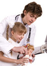 Doctor learn child to do  inoculation. Royalty Free Stock Images
