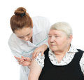 Doctor making senior woman patient an arm subcutaneous insulin women medicine syringe injection vaccination shot on a white Stock Images
