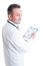Doctor or medic reading financial charts and sales prediction for medicine Royalty Free Stock Photo