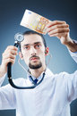 Doctor with money Stock Photo