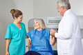 Doctor and mta helping senior woman women in radiology at bone density measurement Royalty Free Stock Image