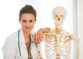 Doctor near human skeleton anatomical model portrait of woman Stock Photography