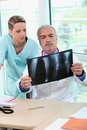 Doctor and nurse examining an xray Stock Photo