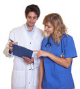 Doctor and nurse looking at clipboard Royalty Free Stock Photo