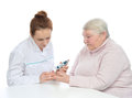 Doctor old woman measuring glucose level blood test Royalty Free Stock Photography