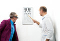 Doctor ophthalmologist patient funny Royalty Free Stock Photos