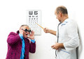 Doctor ophthalmologist patient funny Stock Photography