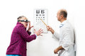 Doctor ophthalmologist patient funny Royalty Free Stock Image