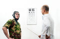 Doctor ophthalmologist patient funny helmet Royalty Free Stock Images