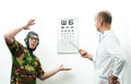 Doctor ophthalmologist patient funny helmet Stock Photography