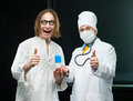 Doctor and patient takes the pill out of the hands of the Royalty Free Stock Photos