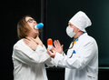 Doctor and patient takes the pill out of the hands of the Royalty Free Stock Photo