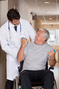 Doctor with patient on wheel chair at hospital Royalty Free Stock Images