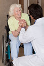 Doctor with patient on wheel chair at hospital Stock Photography