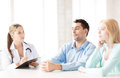 Doctor with patients in cabinet bright picture of Royalty Free Stock Photos