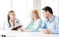 Doctor with patients in cabinet bright picture of Stock Photo
