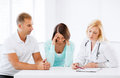 Doctor with patients in cabinet healthcare and medical concept Stock Image