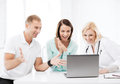 Doctor with patients looking at laptop healthcare medical and technology Stock Photos