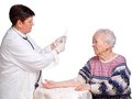 Doctor preparing injection for old woman Royalty Free Stock Photo