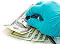 Doctor's hand and banknote Royalty Free Stock Photos