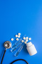 Doctor`s instruments and meds in medical set on blue background space for text Royalty Free Stock Photo