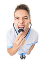 Doctor shouting into stethoscop Royalty Free Stock Photo