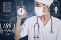 A doctor showing an alarm clock Royalty Free Stock Photo