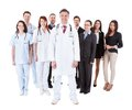 Doctor standing in front of his team Royalty Free Stock Photo