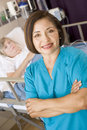 Doctor Standing In Her Patients Room Royalty Free Stock Image
