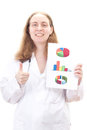 Doctor with statistics showing thumb up professional Royalty Free Stock Image