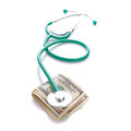 Doctor stethoscope cash dollars over white Stock Photo