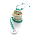 Doctor stethoscope cash dollars over white Royalty Free Stock Photography