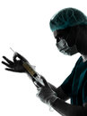 Doctor surgeon anesthetist man holding surgery needle silhouette one caucasian isolated on white background Royalty Free Stock Image