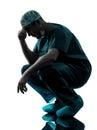 Doctor surgeon man despair tired silhouette Royalty Free Stock Photo