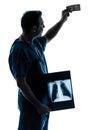 Doctor surgeon man examing dollar bill silhouette Royalty Free Stock Photo