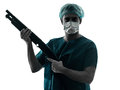 Doctor surgeon man with face mask holding shotgun silhouette Royalty Free Stock Photo