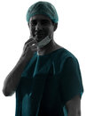 Doctor surgeon man face mask smiling Royalty Free Stock Photo