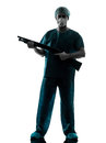 Doctor surgeon man holding shotgun Royalty Free Stock Photos