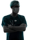 Doctor surgeon man portrait with face mask silhouette Royalty Free Stock Photo