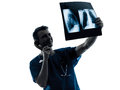 Doctor surgeon radiologist on the phone examining lung torso x one man medical ray image silhouette isolated white background Stock Photography