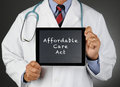 Doctor Tablet Computer Affordable Care Act Royalty Free Stock Photo